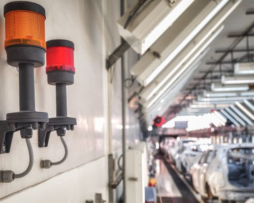 Light fire alarm system under the ceiling of the production room of the automobile plant Fire safety